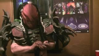 GWAR's Flattus Maximus in a Tap Tap Revenge 3 battle against fans